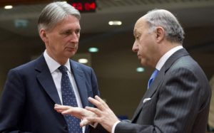 French Foreign Minister Laurent Fabius, right, speaks with British Foreign Minister Philip Hammond during a meeting of EU foreign ministers at the EU Council building in Brussels on Monday, Feb. 9, 2015. European Union foreign ministers have thrown their weight behind fresh diplomatic efforts to end the conflict in Ukraine as they assess whether to expand the EU sanctions list targeting separatists and Russian nationals. (AP Photo/Virginia Mayo)